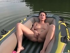 Stunning Youthfull Milky Chick In The Inflatable Boat Masturbating